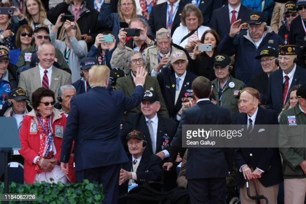 S President Donald Trump and French President Emmanuel Macron greet American Battle of Normandy veterans and family members as the two men arrive at...