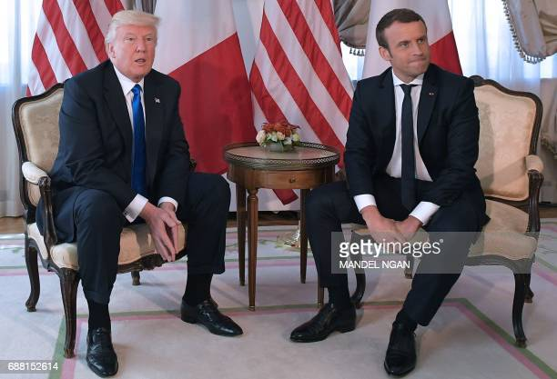 US President Donald Trump and French President Emmanuel Macron meets ahead of a working lunch at the US ambassador's residence on the sidelines of...