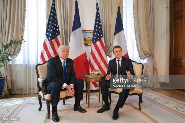 US President Donald Trump and French President Emmanuel Macron speak ahead of a working lunch at the US ambassador's residence on the sidelines of...