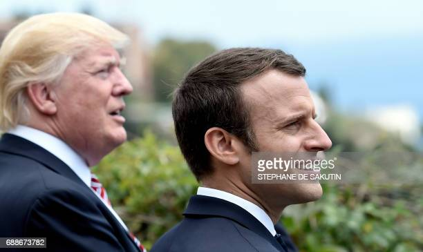 US President Donald Trump and French President Emmanuel Macron watch an Italian flying squadron as they attend the Summit of the Heads of State and...