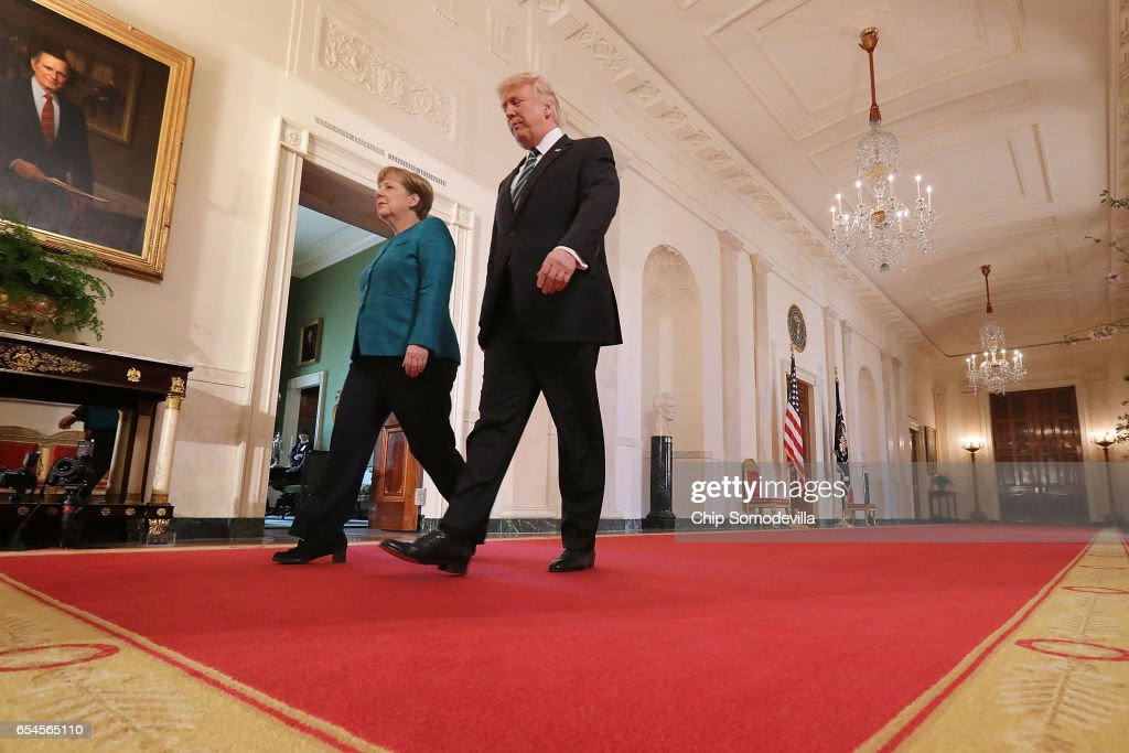 U.S. President Donald Trump (R) and German Chancellor Angela Merkel arrive for a joint press conference in the East Room of the White House March 17, 2017 in Washington, DC. The two leaders discussed strengthening NATO, fighting the Islamic State group, the ongoing conflict in Ukraine and held a roundtable discussion with German business leaders during their first face-to-face meeting.