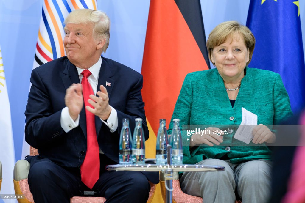 US President, Donald Trump and German Chancellor Angela Merkel attend a panel discussion titled 'Launch Event Women's Entrepreneur Finance Initiative' on the second day of the G20 summit on July 8, 2017 in Hamburg, Germany. Leaders of the G20 group of nations are meeting for the July 7-8 summit. Topics high on the agenda for the summit include climate policy and development programs for African economies.