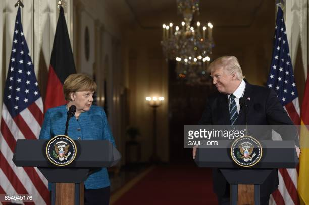 President Donald Trump and German Chancellor Angela Merkel hold a joint press conference in the East Room of the White House in Washington DC on...