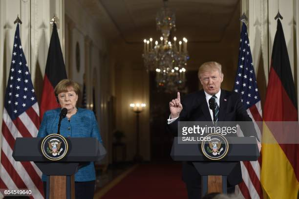 US President Donald Trump and German Chancellor Angela Merkel hold a joint press conference in the East Room of the White House in Washington DC on...