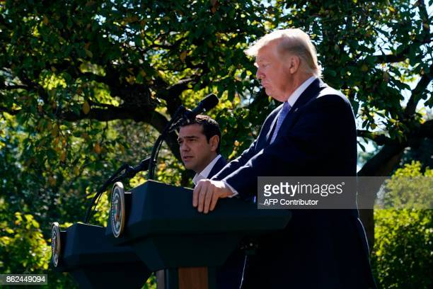US President Donald Trump and Greece's Prime Minister Alexis Tsipras hold a joint press conference in the Rose Garden of the White House in...