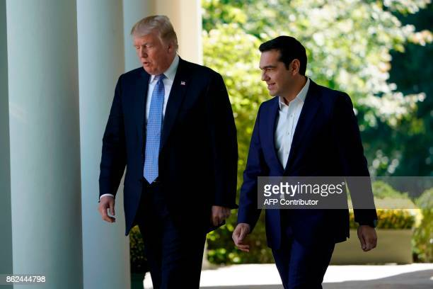 US President Donald Trump and Greece's Prime Minister Alexis Tsipras arrive to hold a joint press conference in the Rose Garden of the White House in...