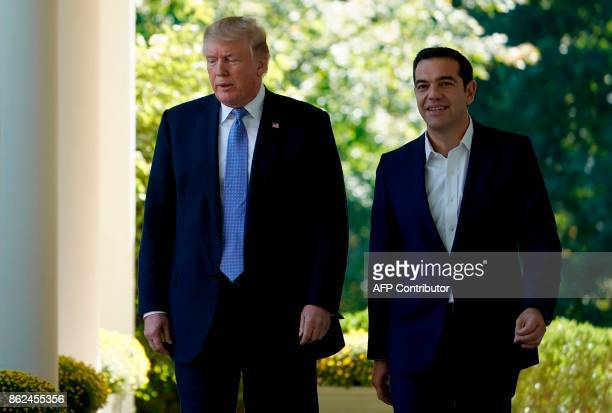 US President Donald Trump and Greek Prime Minister Alexis Tsipras arrive to hold a joint press conference in the Rose Garden of the White House in...