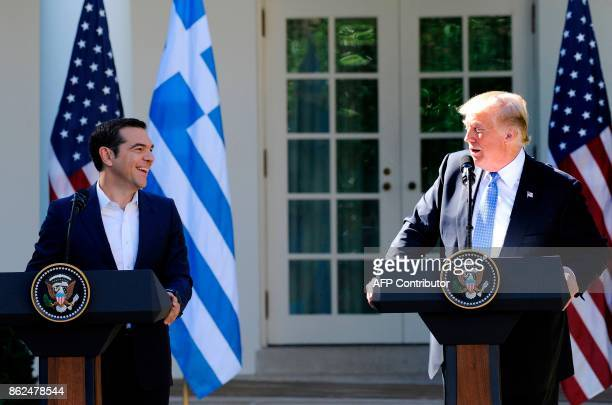 US President Donald Trump and Greek Prime Minister Alexis Tsipras share a laugh while addressing the media in the Rose Garden at the White House in...