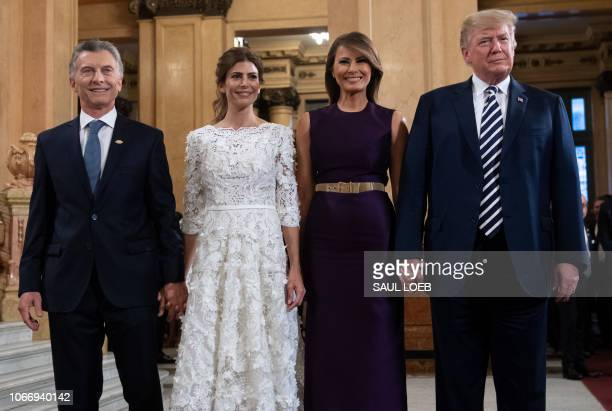 President Donald Trump and her wife US First Lady Melania Trump pose with Argentina's President Mauricio Macri and his wife Argentina's First Lady...