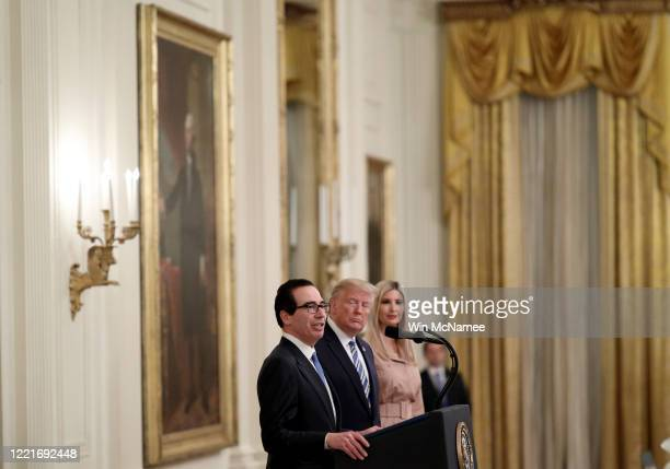 President Donald Trump and his daughter Ivanka listen as U.S .Treasury Secretary Steven Mnuchin speaks during an event on supporting small businesses...