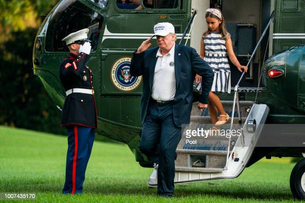 S President Donald Trump and his granddaughter Arabella Rose Kushner step off Marine One on the South Lawn as they return from a weekend stay in...