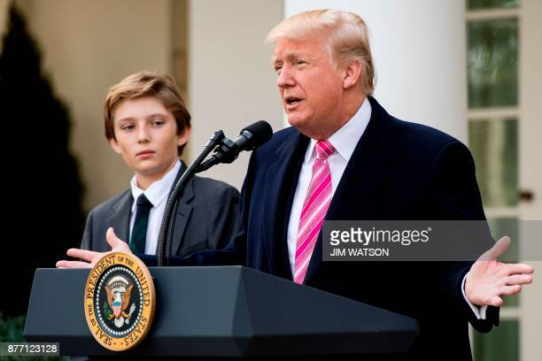 US President Donald Trump and his son Barron speak before pardoning the Thanksgiving turkey Drumstick in the Rose Garden of the White House in...