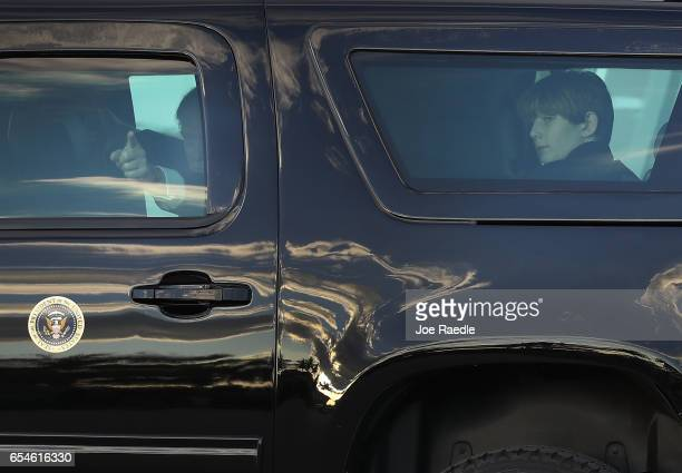 President Donald Trump and his son Barron Trump sit in a vehicle together after arriving on Air Force One at the Palm Beach International Airport to...