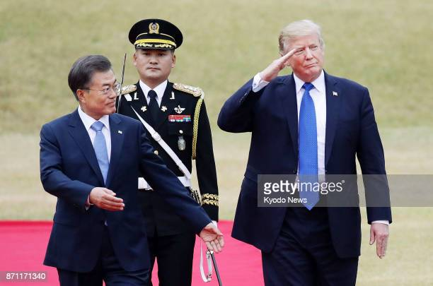 US President Donald Trump and his South Korean counterpart Moon Jae In attend a welcome ceremony for Trump in Seoul on Nov 7 2017 ==Kyodo