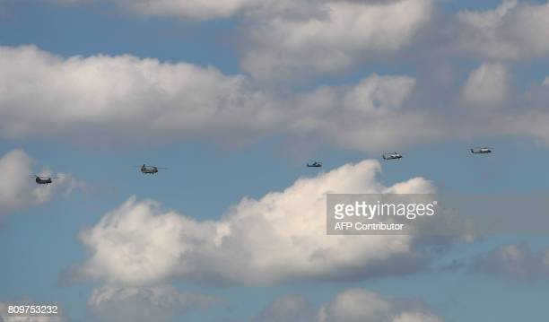 US President Donald Trump and his team make their way in Marine One after arrival at the airport in Hamburg northern Germany on July 6 2017 Leaders...