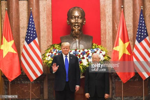 US President Donald Trump and his Vietnamese counterpart Nguyen Phu Trong pose before a meeting at the Presidential Palace in Hanoi on February 27...