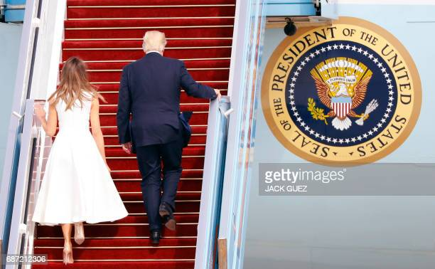 US President Donald Trump and his wife First Lady Melania Trump board Air Force One from Ben Gurion International Airport in Tel Aviv on May 23 bound...