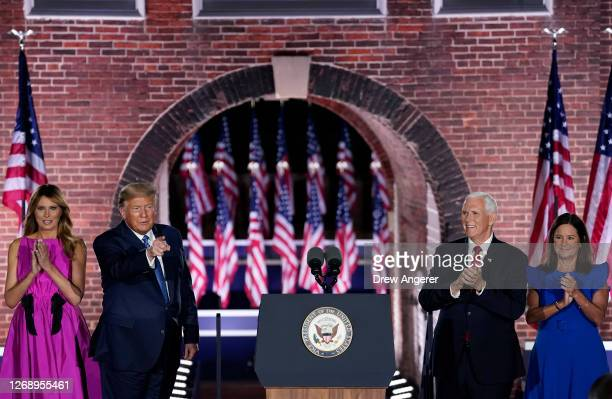 President Donald Trump and his wife first lady Melania Trump stand with Mike Pence and his wife Karen Pence after his acceptance speech for the vice...