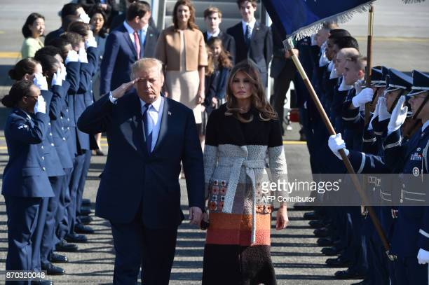 US President Donald Trump and his wife Melania are welcomed upon arrival at Yokota Air Base in Fussa City Tokyo prefecture on November 5 2017 Trump...