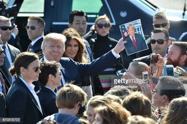 President Donald Trump and his wife Melania are welcomed upon arriving at Yokota Air Base in Tokyo on November 5 2017 Trump touched down in Japan...