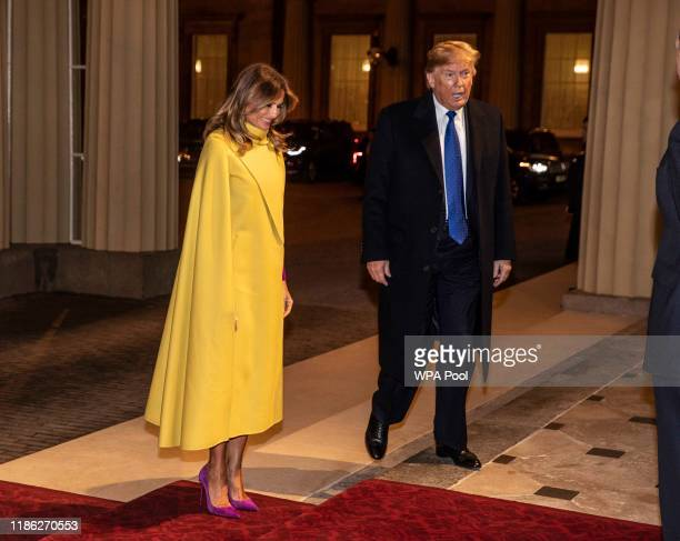 President Donald Trump and his wife Melania arrive at a reception for NATO leaders hosted by Queen Elizabeth II at Buckingham Palace on December 3,...