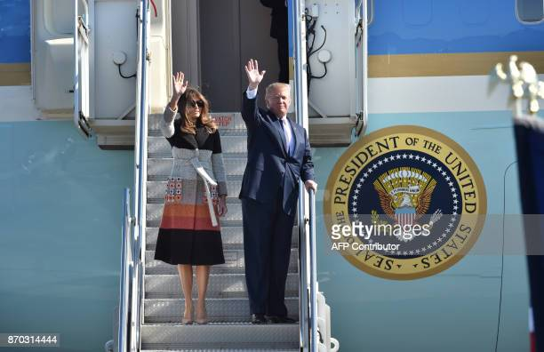 US President Donald Trump and his wife Melania arrive at Yokota Air Base in Tokyo on November 5 2017 Trump touched down in Japan kicking off the...