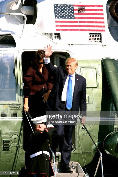 US President Donald Trump and his wife Melania arrive at Yokota Air Base on November 7 2017 in Fussa Tokyo Japan Trump is on 11day tour to Asia
