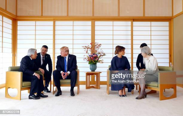 US President Donald Trump and his wife Melania talk with Emperor Akihito and Empress Michiko during their meeting at the Imperial Palace on November...