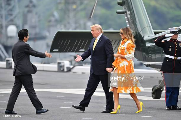 President Donald Trump and his wife Melania Trump are greeted by Shinzo Abe and Akie Abe onboard the Japan's navy ship Kaga on May 28 2019 in...