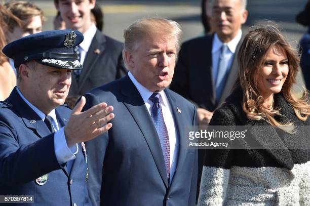 S President Donald Trump and his wife Melania Trump are welcomed upon their arrival at Yokota Air Base in Tokyo Japan on November 5 2017