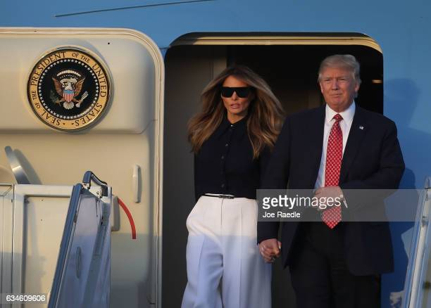 President Donald Trump and his wife Melania Trump arrive on Air Force One at the Palm Beach International airport as they prepare to spend part of...