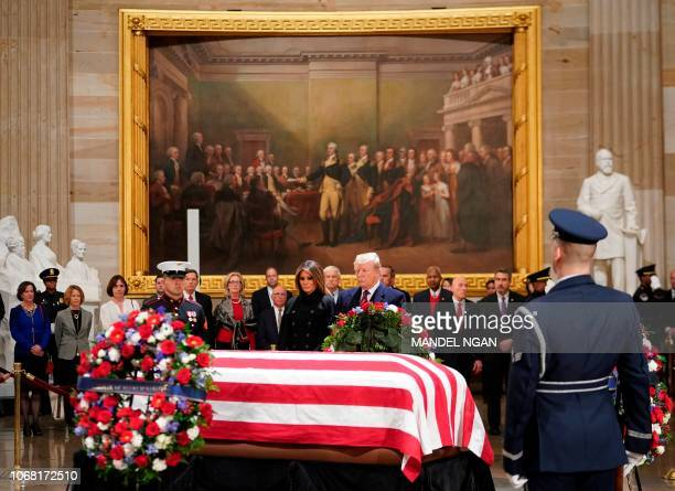 US President Donald Trump and his wife Melania Trump arrive to pay their respects to former US President George H W Bush as he lies in state in the...
