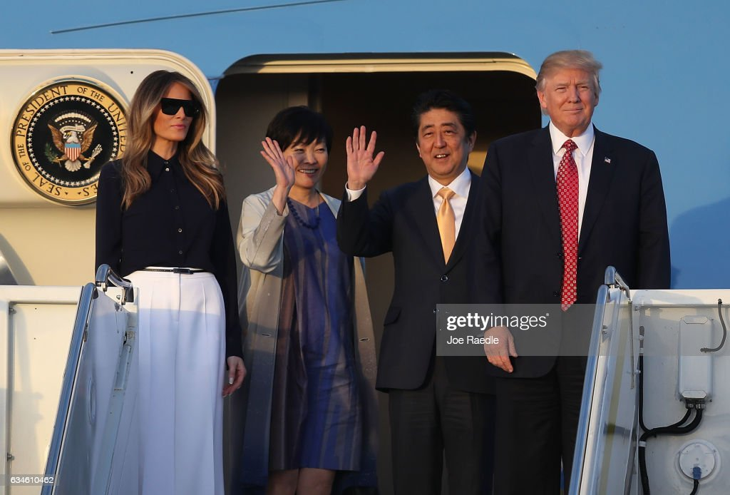 President Donald Trump and his wife Melania Trump arrive with Japanese Prime Minister Shinzo Abe and his wife Akie Abe on Air Force One at the Palm Beach International airport as they prepare to spend part of the weekend together at Mar-a-Lago resort on February 10, 2017 in West Palm Beach, Florida. The two are scheduled to get in a game of golf as well as discuss trade issues.