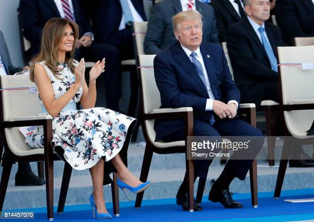 President Donald Trump and his wife Melania Trump attend the traditional Bastille day military parade on the ChampsElysees on July 14 2017 in Paris...