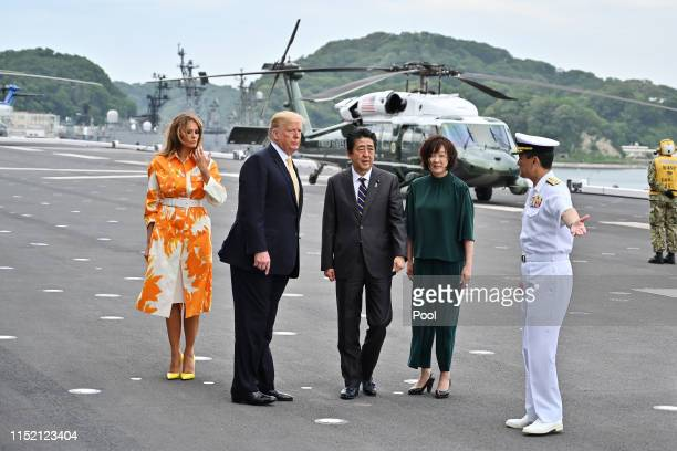 President Donald Trump and his wife Melania Trump flanked by Shinzo Abe and Akie Abe with the captain of the ship Mr Mizuta onboard the Japan's navy...