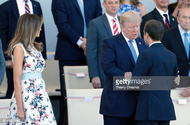 President Donald Trump and his wife Melania Trump French President Emmanuel Macron attend the traditional Bastille day military parade on the...