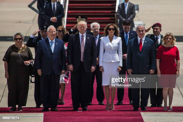 President Donald Trump and his wife Melania Trump standing surrunded by Israeli Prime Minister Benjamin Netanyahu and his wife Sara Netanyahu as...