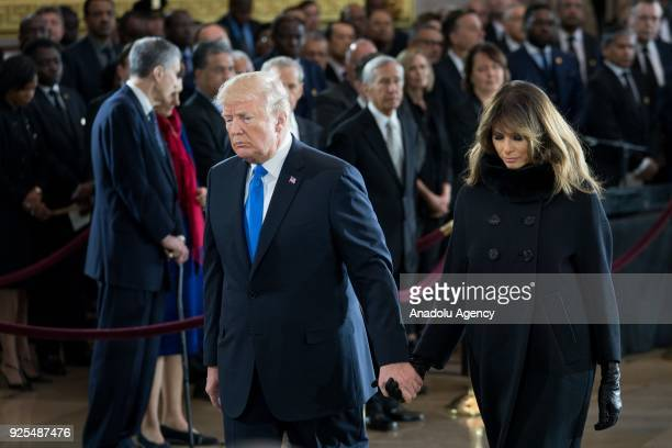 S President Donald Trump and his wife Melania Trump walk back to their seats during a ceremony in the Capitol in Washington DC United States on...