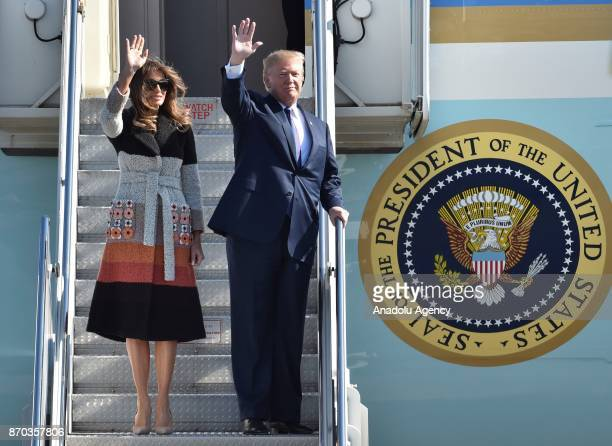 S President Donald Trump and his wife Melania Trump wave as they arrive at Yokota Air Base in Tokyo Japan on November 5 2017