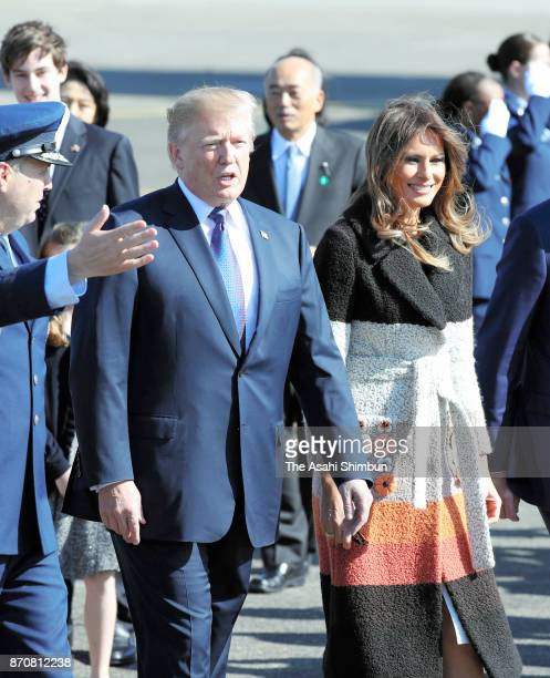 US President Donald Trump and his wife Melania wave on arrival at Yokota Air Base on November 5 2017 in Fussa Tokyo Japan Trump is on 11day tour to...