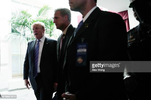 S President Donald Trump and House Majority Leader Rep Kevin McCarthy leave after a meeting with House Republicans at the US Capitol June 19 2018 in...