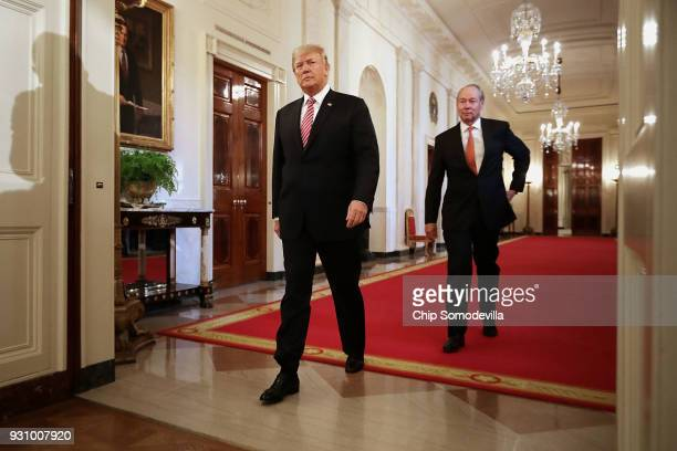 S President Donald Trump and Houston Astros owner Jim Crane arrive for a celebration of the team's World Series victory in the East Room of the White...