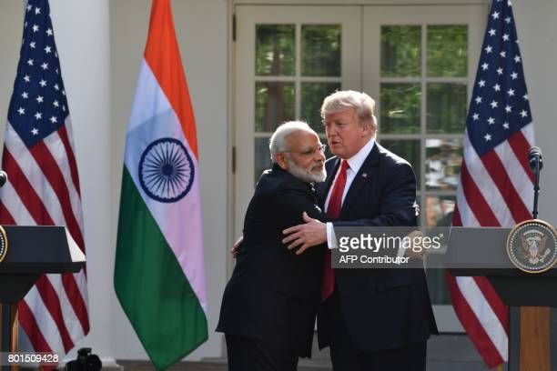 US President Donald Trump and Indian Prime Minister Narendra Modi embrace during a joint press conference in the Rose Garden at the White House in...