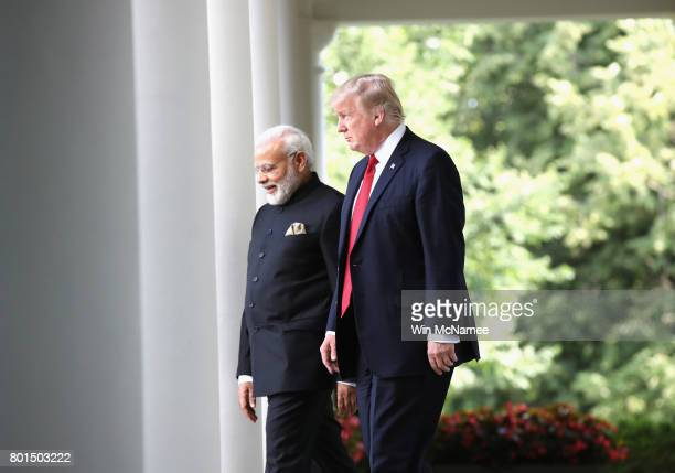 S President Donald Trump and Indian Prime Minister Narendra Modi arrive before delivering joint statements in the Rose Garden of the White House June...