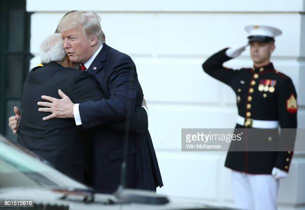 S President Donald Trump and Indian Prime Minister Narendra Modi embrace as Modi departs the White House June 26 2017 in Washington DC Trump and Modi...