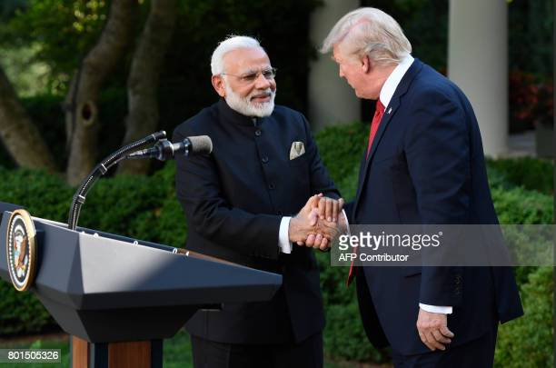 US President Donald Trump and Indian Prime Minister Narendra Modi shake hands after speaking to the press in the Rose Garden of the White House in...