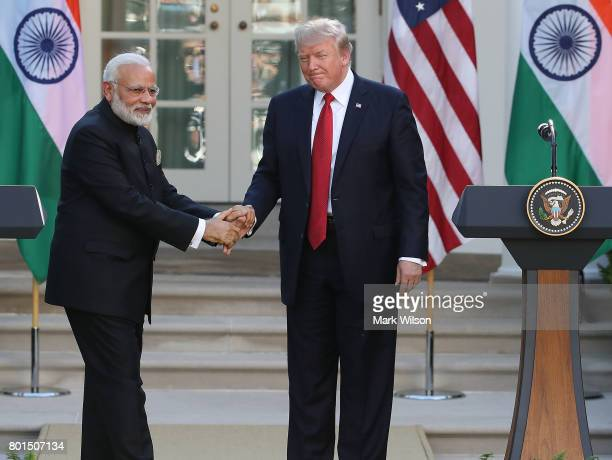 S President Donald Trump and Indian Prime Minister Narendra Modi shake hands while delivering joint statements in the Rose Garden of the White House...