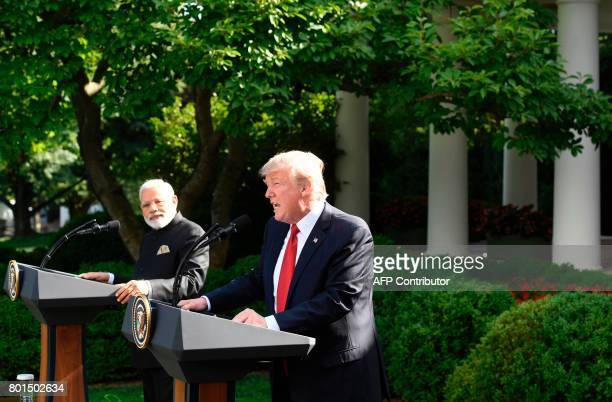 US President Donald Trump and Indian Prime Minister Narendra Modi speak to the press in the Rose Garden of the White House in Washington DC on June...