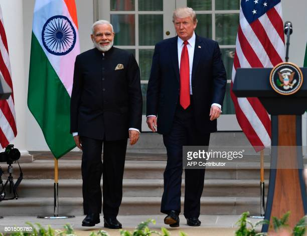 US President Donald Trump and Indian Prime Minister Narendra Modi walk after a press conference in the Rose Garden of the White House in Washington...