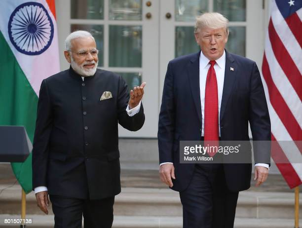 S President Donald Trump and Indian Prime Minister Narendra Modi walk up to deliver joint statements in the Rose Garden of the White House June 26...